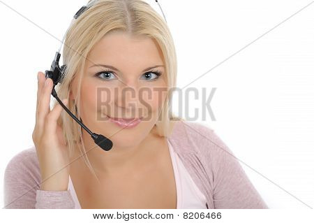 Young Woman With Microphone And Computer Having Online Conversation Throw Internet. Help Desk Assist