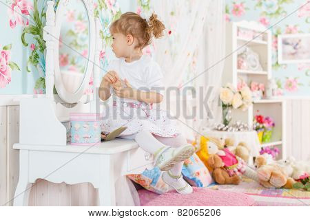 Little Girl Playing With Cosmetics