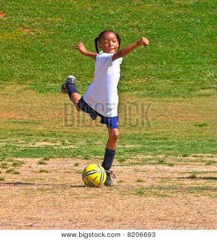 Girl's Soccer Kicking The Ball