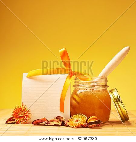 Honey jar and empty white card composition