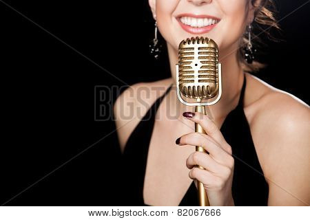 Beautiful Girl Vocalist With Smile Holding Golden Vintage Microphone