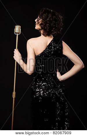 Beautiful Slim Singer Girl Holding Golden Vintage Microphone