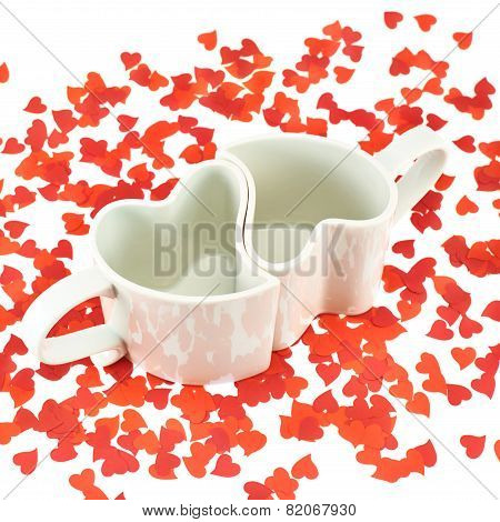 Two hearts shaped cups composition