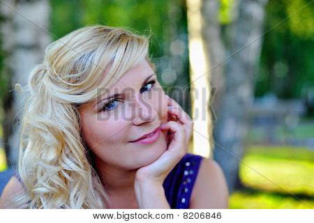 Beautiful Young Woman With Fashion Hairstyle Outdoors In Summer Park. Blurred Background