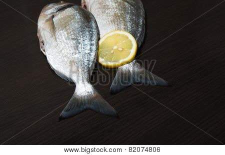 Two Fresh Dorados On Wenge Table