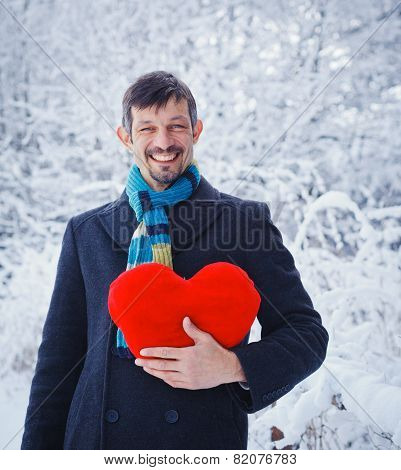 Man holding red heart.