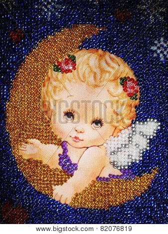 Angel embroidered with beads