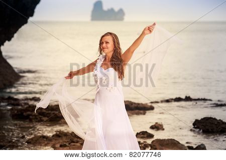 Bride Whirls On Sandy Beach