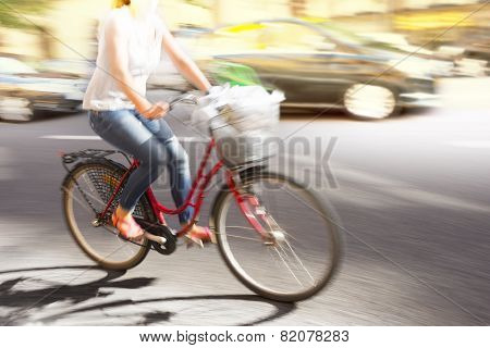 Woman On Red Bike
