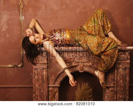 beauty sensual young woman  oriental style in luxury room