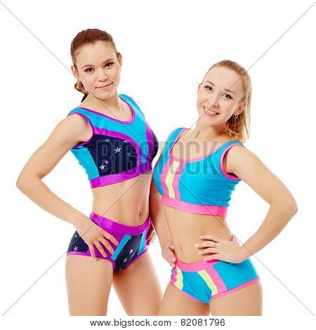 Smiling sportswomen posing at camera