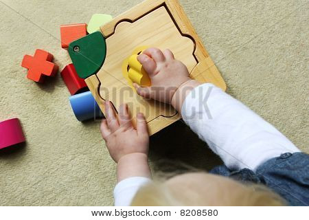 Child Playing With Shape Sorter
