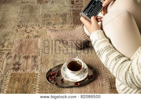 Woman Chatting With Smartphone At Home