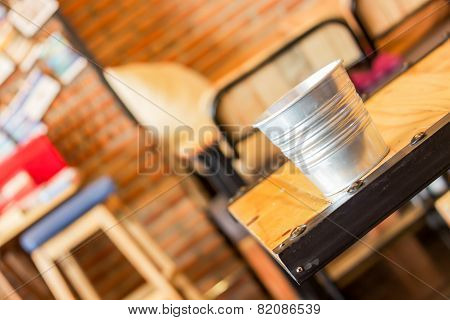 Empty Bucket On The Table In Coffee Shop
