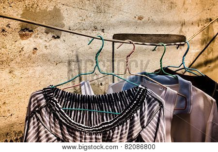 Old clothes hangers in the sunlight
