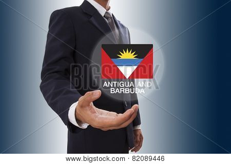 Businessman hand showing Antigua and Barbuda Flag