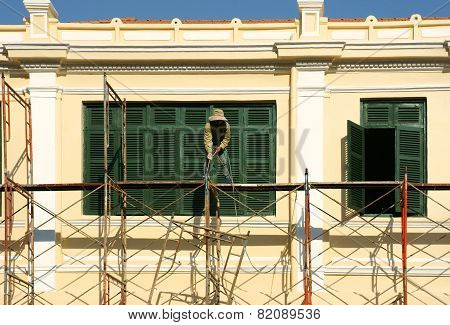 Asian Contruction Worker On Scaffold
