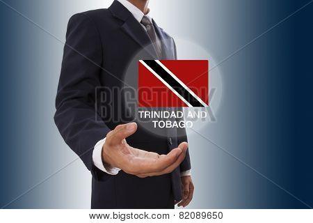 Businessman hand showing Trinidad and Tobago Flag