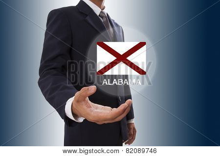Businessman hand showing Alabama Flag