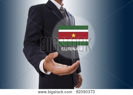 Businessman hand showing Suriname Flag