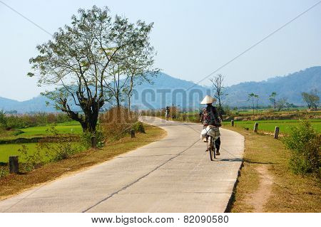 Vietnamese Woman Riding Bicycle