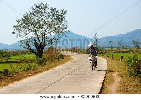 Vietnamese Woman Riding Bicycle