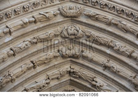 Paris - West facade of Notre Dame Cathedral. Archivolts of The Saint Anne portal