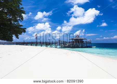 Main pier and white sand beach on Pulau Sipadan island near Borneo Malaysia