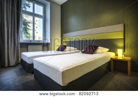 Two Single Beds In Green Hotel Room