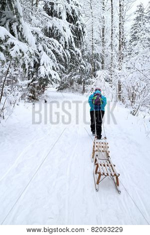 Woman With Sledges