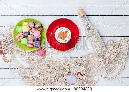 Cup And Macaron With Net And Bottle