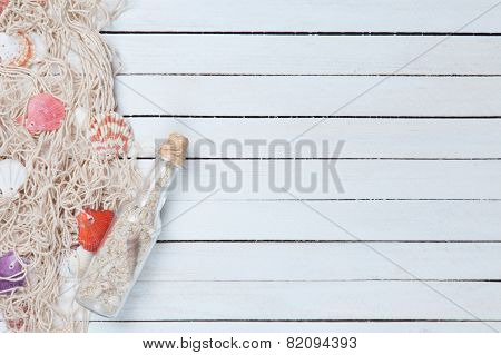 Net And Bottle Wit Shells
