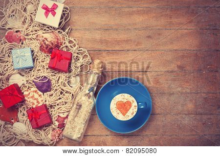 Cup, Gift And Net With Shells And Bottle