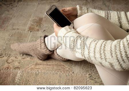 Cross Legged Woman Holding Smartphone