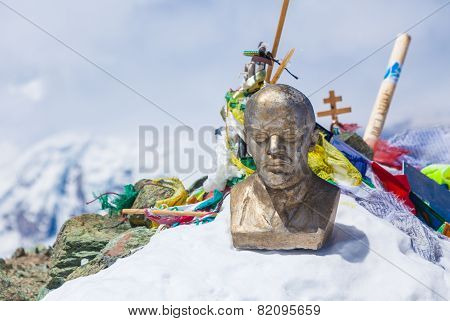 Leinin head statue at the top of Lenin Peak Pamir Mountains Kyrgyzstan