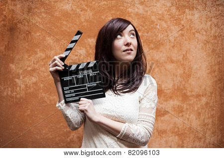 Young Woman 70S Hippie Style Closeup With Clapperboard