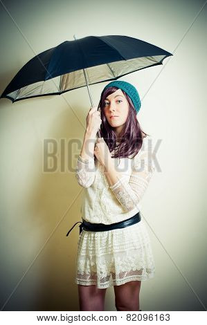 Young Woman In 70S Hippie Style Posing With Umbrella