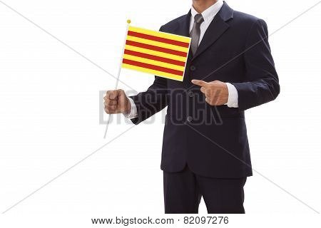 Businessman in suit holding Catalonia Flag