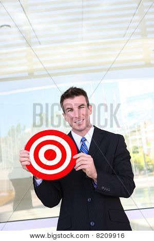 Business Man Holding Target