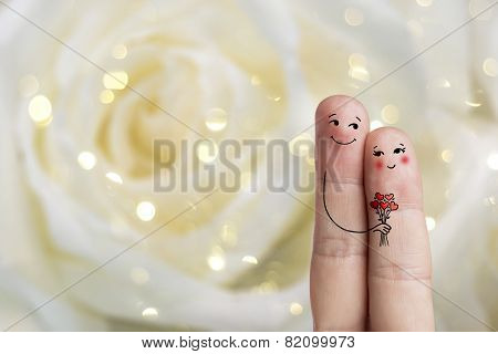 Finger art. Lovers is embracing and holding bouquet. Stock Image