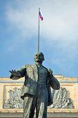 stock photo of lenin  - Lenin monument and Russian flag Orel Russia vertical - JPG