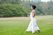 foto of namaste  - Beautiful woman practicing yoga in the park - JPG