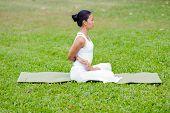 picture of padmasana  - Beautiful woman practicing yoga in the park - JPG