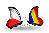 stock photo of chad  - Two butterflies with flags on wings as symbol of relations Poland and Chad Romania - JPG