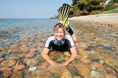 stock photo of fin  - Young lady wearing a wetsuit - JPG