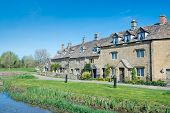 stock photo of slaughter  - Cottages in the beautiful Cotswold village of Lower Slaughter - JPG