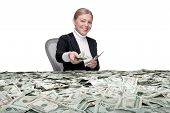 picture of cash  - portrait of young woman sitting behind the table full of cash - JPG