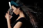 image of girls guns  - Dangerous Chinese woman with handgun on black studio background - JPG