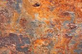 stock photo of slab  - Abstract unique pattern of a stone slab in orange - JPG