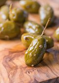 foto of kalamata olives  - Green olives marinated with coriander over olive wood board selective focus closeup - JPG